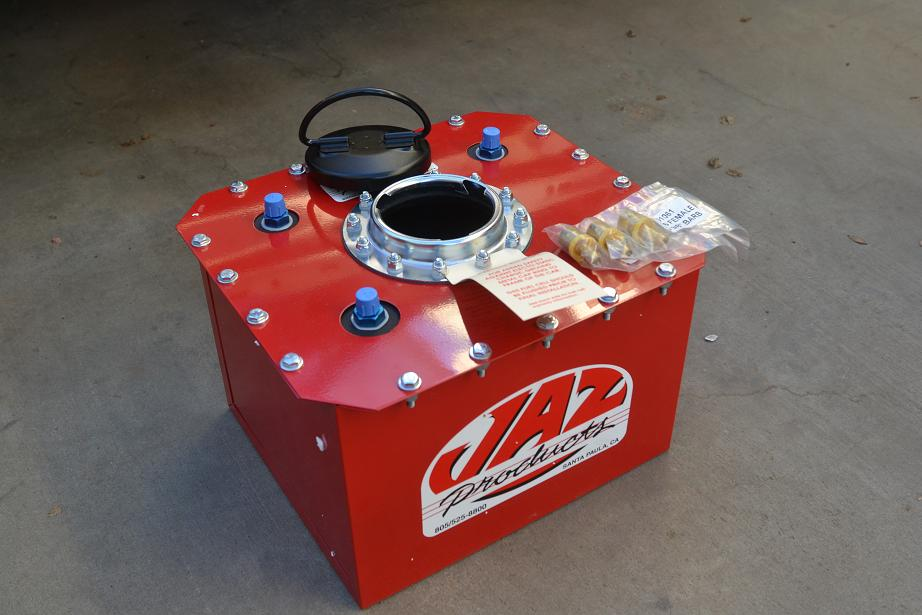Not your ordinary fuel cell.  These are custom made for us for installation in stunt cars.  3 outlets handle late model fuel injection cars as well as carburated cars.