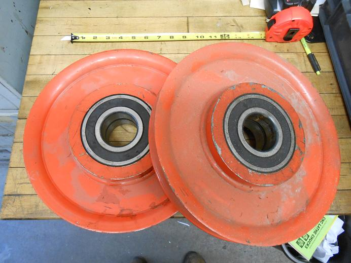 2 Big steel pulleys.  12 diameter with 1 groove.  Really heavy duty.  Each pulley has 2 FAG 6311 sealed bearings.  Approx 2.125 Shaft.  About 2-1/4 wide. Only 2 left.