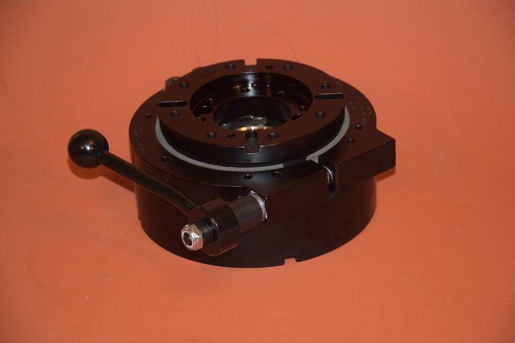 Camera Crane Swivel Base with friction brake.  Designed to fill the need for a low profile swivel base with a friction brake to mount a Tecnocrane or Moviebird on a compact motorized camera car, this swivel base is only 2-7/8 inches high, but has a 17,000 pound capacity bearing.  Both top and bottom of this base are pocketed, keyway slotted  and tapped for our Stainless Steel Billet Mitchell Camera spuds, and also are tapped for your custom mount.  The fricton brake has a splined shaft to allow brake adjustment even in the most limited space.