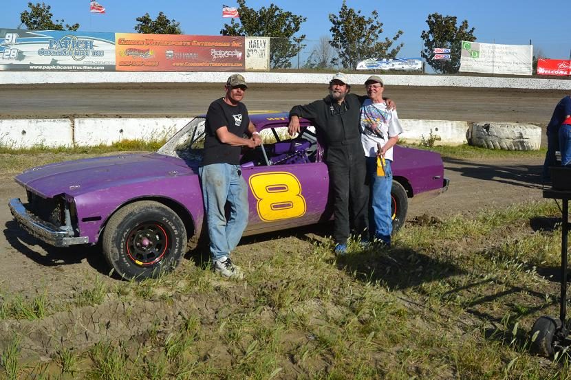 Here is the Novas first race, May 5, 2012.  Left to right:  Mike Leland, Matt, and LuLu.  The car felt good, but tossed both fanbelts about 10 laps into the main.