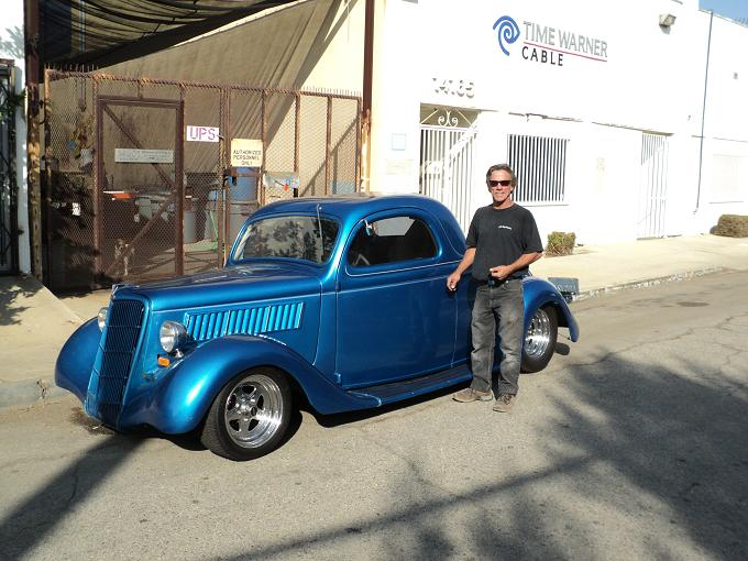 Tony Vandenecker and his 1935 Ford Coupe.  He drives this car daily.